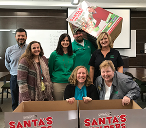 Staff Senate officers with the Santa's Helpers toy collection boxes